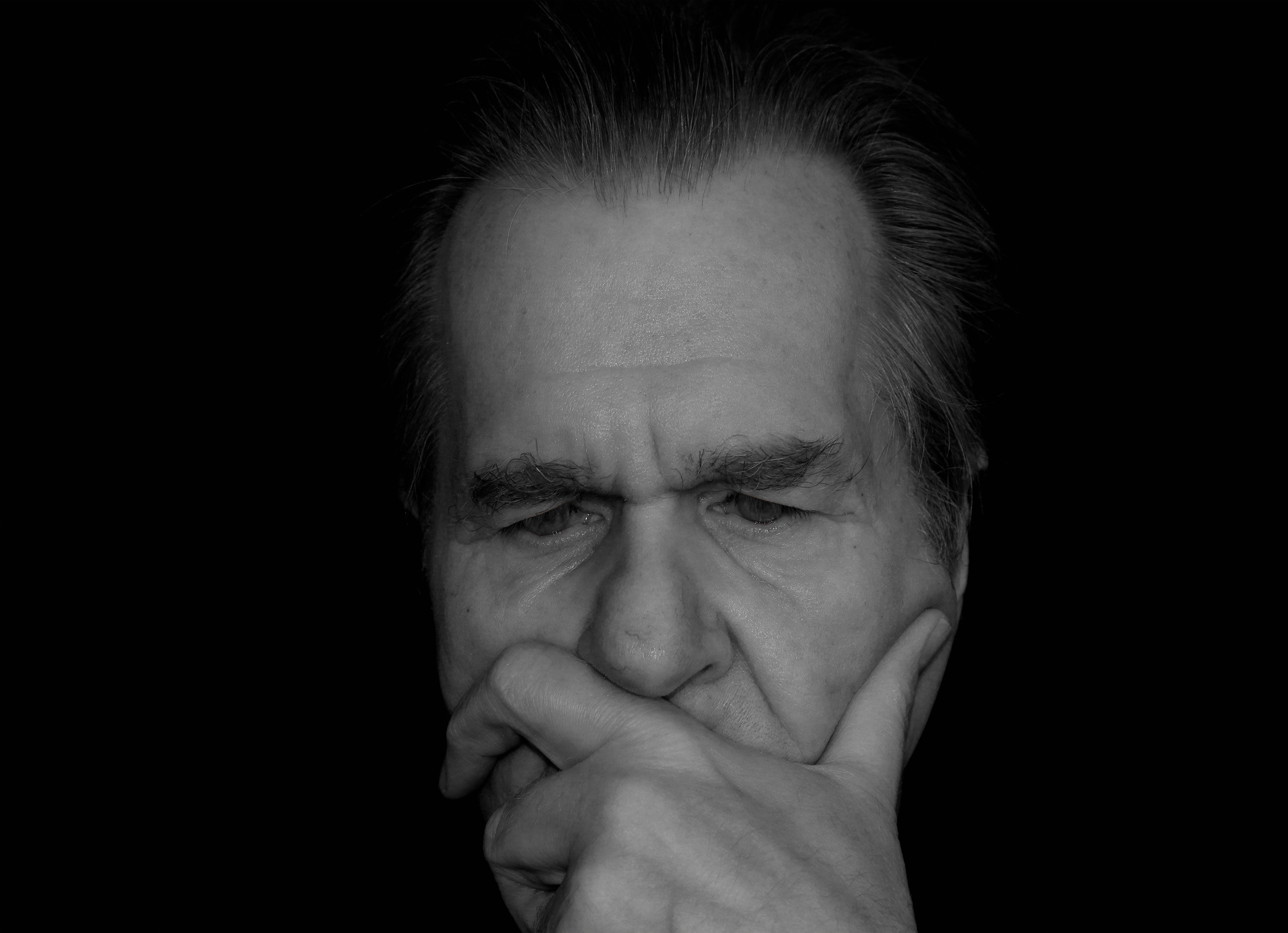 elderly man thinking about Cognitive Behavioral Therapy